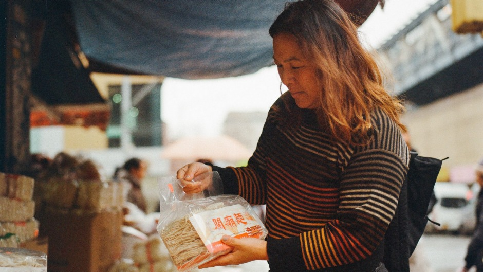 American connection: Hetty McKinnon browsing for ingredients in Chinatown in New York.