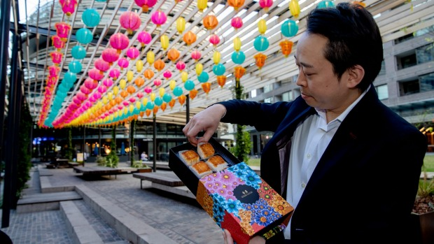 XOPP and Golden Century restaurateur Billy Wong at Darling Square with mooncakes from his restaurants.