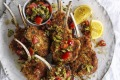Parmesan-crumbed lamb cutlets with tomato and olive salsa.