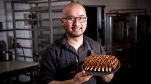 Khanh Nguyen with a shortcrust pastry-wrapped rack of lamb.