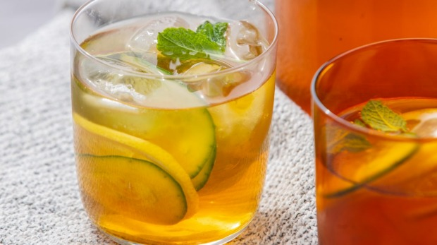 Iced tea with lemon, mint and cucumber.