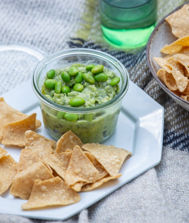 Avocado and edamame dip with tortilla chips.