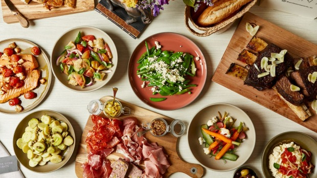 Charcuterie, salads, meat and other dishes from the hampers.