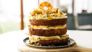 Sunshine on a plate: Hummingbird cake stacked with lemon curd and cream cheese icing, and topped with golden-hued ...