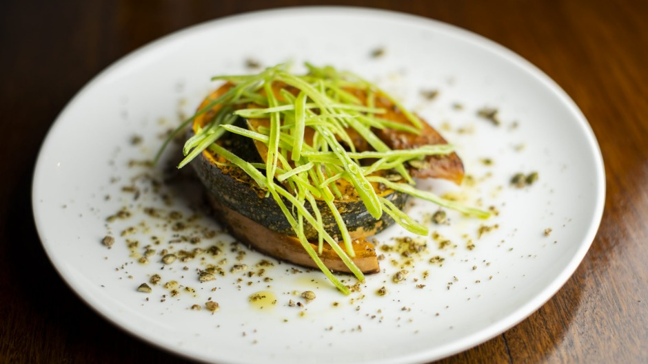 The roast pumpkin is served skin-on and dusted with a native dukkah.