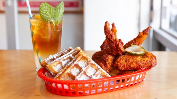 Fried chicken and waffles, available on weekends at Belles Hot Chicken.