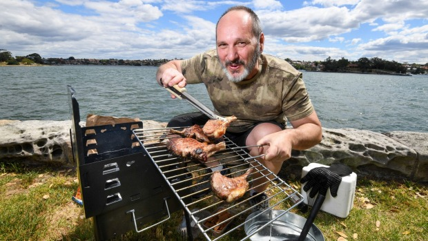 BBQAroma owner Nick Angelucci cooking on his portable Ferraboli picnic grill in a Leichhardt park.