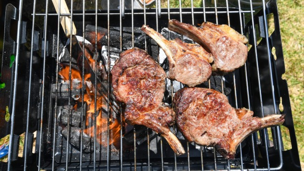 Steak and chops cooked over charcoal outdoors by Nick Angelucci.