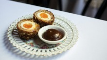 The Milan Cricket Club's scotch egg has a soft-set yolk at its centre.