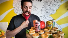 Alex Dedic of Mama Mijiras Cafe at Prahran Market. Alex with a baker's dozen of gourmet party pies and craft beer for ...