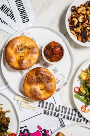 Chin Chin's grand final party pack featuring butter chicken pies, spring rolls and crab rice.