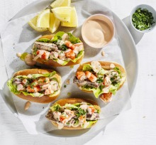 Seafood sandwich with spicy cocktail sauce.