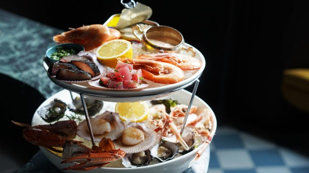 The towering seafood platter with crab legs akimbo.