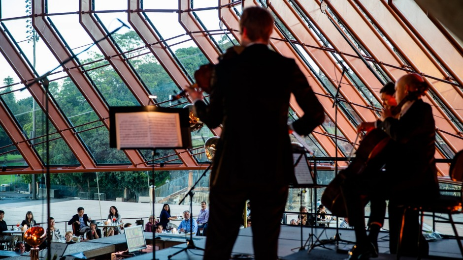 Sydney Symphony Orchestra musicians treating Bennelong guests to dinner and a show.