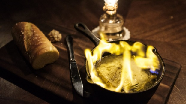 The Drunken Manchego, served flaming at the table with spears of rosemary.