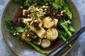 Simple steamed scallops and tofu with a spicy dressing.
