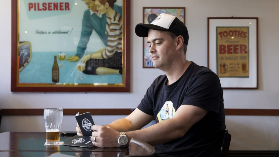 Resch's Appreciation Society co-founder Matt Henricks at the Forest Lodge Hotel, with one of the new fan-made Resch's ...