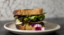 The zucchini and haloumi burger is a luscious bundle of pickled beetroot, salty cheese and a fat vegetable fritter.