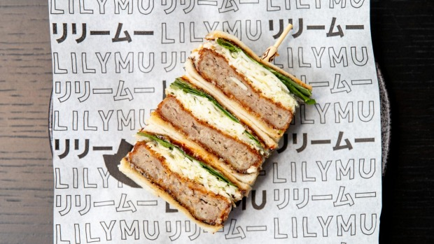 Duck katsu sando with layers of crumbed minced duck, chilli jam, raw shredded cabbage and Thai herbs.