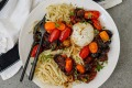 Pasta with jammy slow-roasted tomatoes andcreamy burrata cheese.