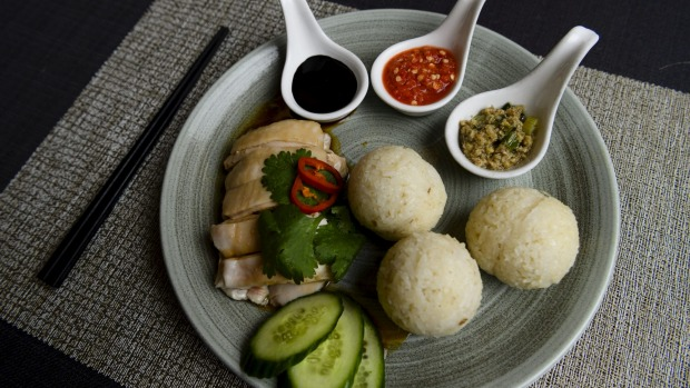 Hainan chicken accompanied with rice balls, rather than the usual plate of chicken rice.
