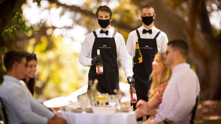 Our Boys and Girls staff serve wine at a luxury lunch styled by Melbourne Picnic Collective.