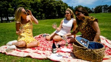 Friends having a picnic in Prince Alfred Park, Sydney.