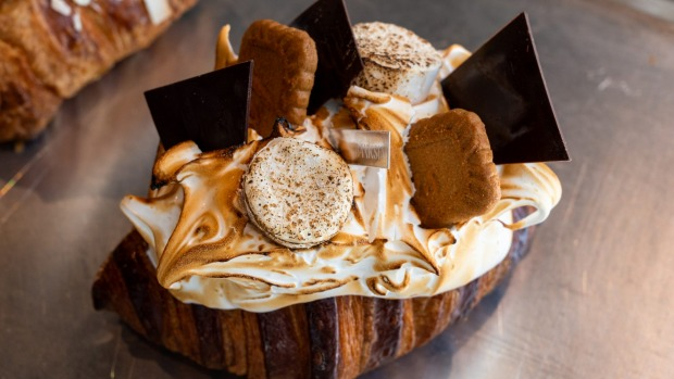 A close-up of the s'mores croissant, with torched marshmallows, chocolate shards and Lotus biscuits.