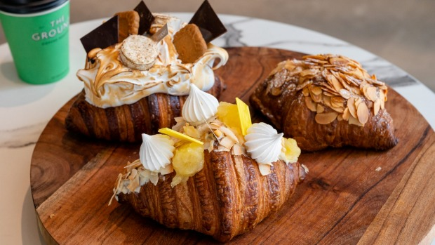 Banksia Bakehouse's famous croissants (from back left) the s'mores croissant, the Pina Colada croissant and the almond ...