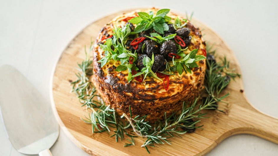 Baked spiced ricotta cake with a central layer of jammy tomatoes.