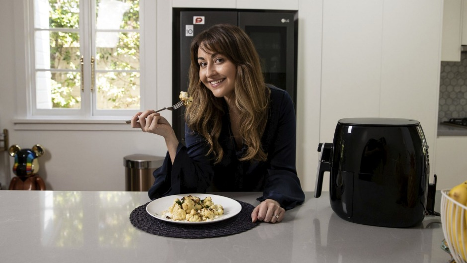 Air fryer fan Graziela Oborn makes air fried cauliflower with tzatziki, pine nuts and feta at her home in Balgowlah, Sydney.