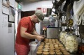 Flower Drum bakery co-ownerJohnny Ageletos makes fruit mince pies at Flower Drum in Newtown.