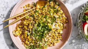 Charred corn kernels coated in creamy, cheesy dressing.