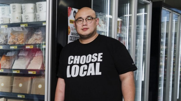 Haymarket IGA now stock some of the best Asian chefs in the city's ready-meals. LtoR Will Mahusey of Sydney Cebu Lechon, Keita Abe of Chaco Bar, Junda Khoo of HoJiak and Sam Young of Lotus. Photographed Thursday 16th July 2020. Photograph by James Brickwood. SMH NEWS 200716