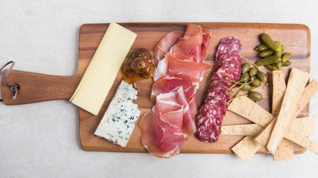 Add variety to a charcuterie board by placing smaller pieces next to larger pieces.