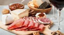Fold larger slices of cured meat into rounds and fan  them out.