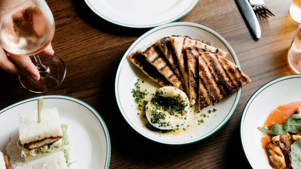 Grilled garlic flat bread, whipped ricotta, smoked olive oil and bottarga at the Hobsons Bay Hotel.