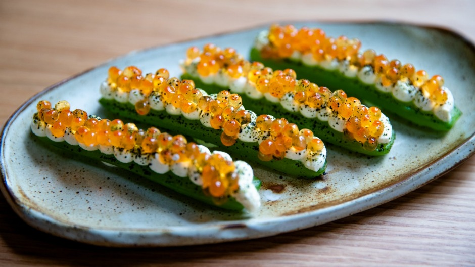 Pressed cucumber with smoked sour cream and salmon roe.