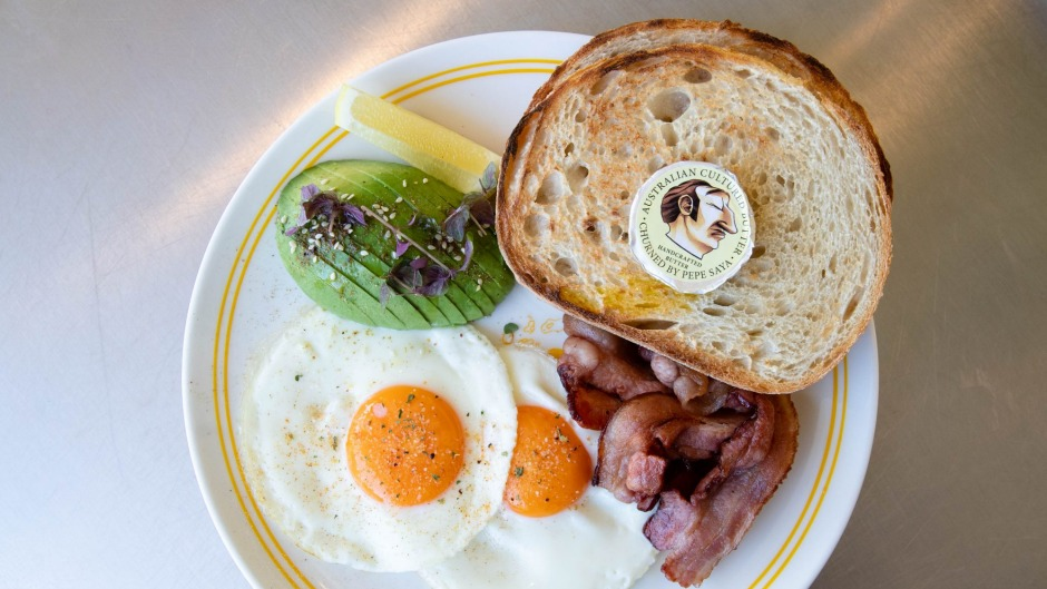 The fried eggs and toast, with avocado and bacon.