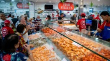 Customers inspect the daily catch at Sydney Fish Market.