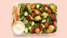 It's easy to make your own pita chips for this falafel salad.