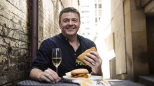 John Noble, director of the Champagne Bureau Australia, suggests champagne and a chicken schnitzel sandwich to be a ...