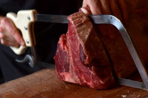 Bistecca executive chef Pip Pratt cuts steak to order at the Sydney CBD restaurant.
