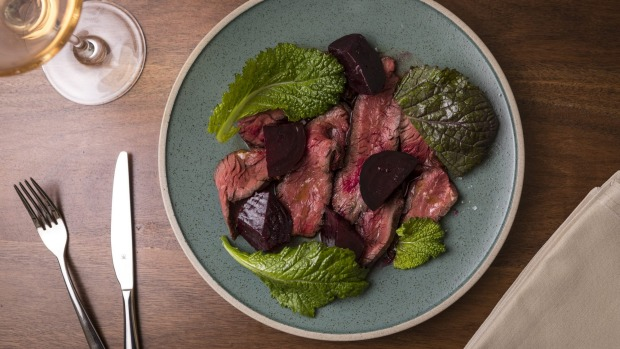 Hanger steak with mustard leaf and beetroot.