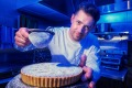 Tarts Anon chef Gareth Whitton dusting his signature pear creation.