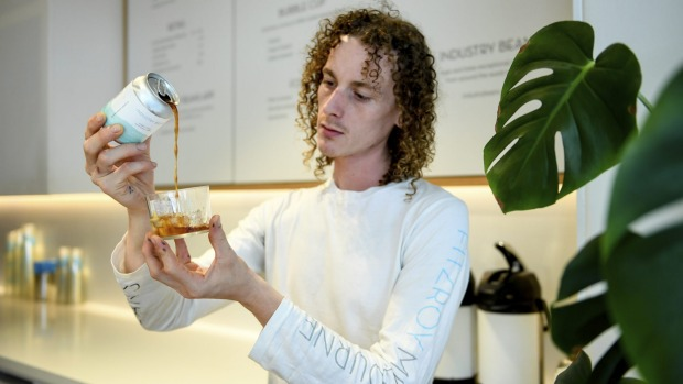James Kuhle, store manager of Industry Beans on Little Collins Street in Melbourne, pouring the roaster's new cold brew ...