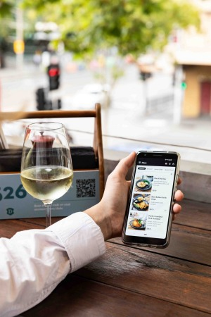 Phones at the table: The Mr Yum online ordering platform in action.