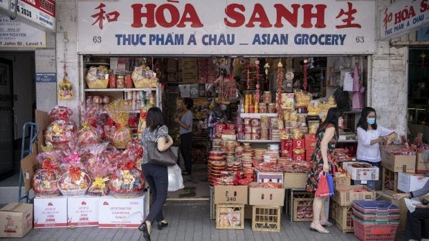 Lunar New Year sweets surround the entrance of Hoa Sanh grocery in Cabramatta.