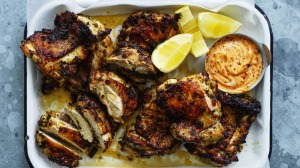 Barbecued chicken thighs with spicy mayo.