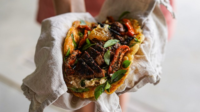 Flatbread loaded with coffee spice-rubbed lamb, honey and feta.
